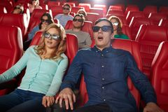 Friends watching horror movie in 3d theater Royalty Free Stock Images