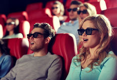 Friends watching horror movie in 3d theater. Cinema, technology, entertainment and people concept - friends with 3d glasses watching horror or thriller movie in Royalty Free Stock Photos