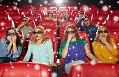 Friends watching horror movie in 3d theater Stock Images