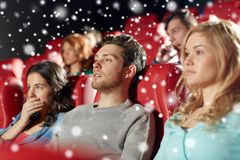 Friends watching horror movie in theater Stock Photo