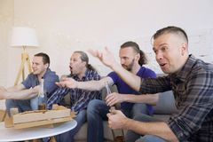 Friends watching loosing football match royalty free stock photos