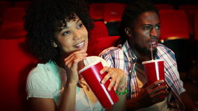 Friends watching movie stock footage