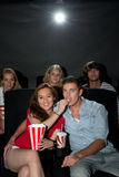 Friends watching movie at cinema Stock Images
