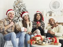 Friends watching movie and having fun at Christmas eve. stock images