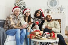 Friends watching movie and having fun at Christmas eve. Friends watching movie and having fun together on Christmas eve, copy space royalty free stock images