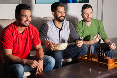 Friends watching a movie at night Royalty Free Stock Photo