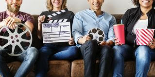 Friends watching movie together on couch Royalty Free Stock Image