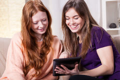Friends watching photos on tablet Stock Photo