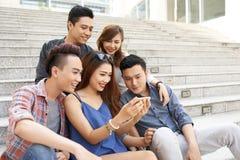 Friends watching photos Stock Photos