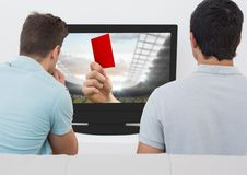 Friends watching soccer match on television. Against white background Royalty Free Stock Photography