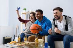 Friends watching sport on TV Stock Photo