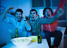 Friends watching sports on TV Royalty Free Stock Photo