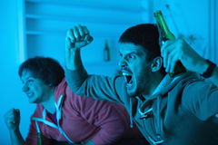 Friends watching sports on TV Royalty Free Stock Photos