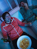 Friends watching sports on TV Stock Image