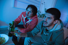 Friends watching sports on TV Stock Photos
