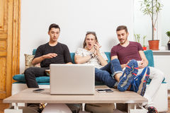 Friends watching together a ball game Stock Image