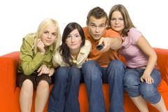 Friends watching TV Stock Photography