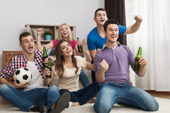 Friends watching TV Stock Photos