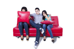 Friends watching TV - isolated Royalty Free Stock Photo