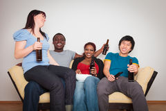 Friends Watching Tv royalty free stock photography