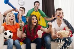 Friends watching TV sports game Stock Images