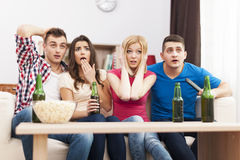 Friends watching TV Royalty Free Stock Photos