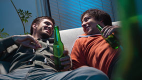 Friends watching TV Royalty Free Stock Photo