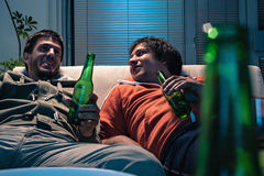 Friends watching TV Stock Images