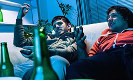 Friends watching TV Royalty Free Stock Image