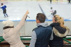 Friends wathcing ice hockey. Couple Stock Photos