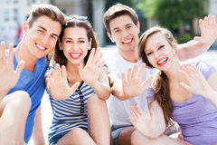 Friends waving Stock Images