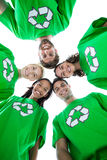 Friends wearing recycling tshirts forming huddle Royalty Free Stock Images