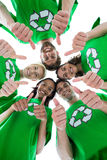 Friends wearing recycling tshirts forming huddle Stock Images
