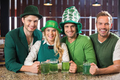 Friends wearing St. Patricks day associated clothes Stock Images