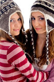 Friends wearing woolen cap and looking at camera Royalty Free Stock Images