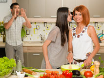 Friends whispering secret recipe Stock Photos