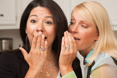 Friends Whispering Secrets Stock Image