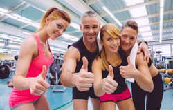 Friends whit thumbs up smiling after a training Royalty Free Stock Image
