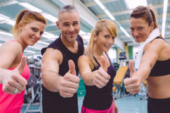 Friends whit thumbs up smiling after a training Royalty Free Stock Images
