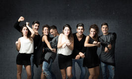 Friends in a wild dancing stock images