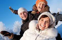 Friends on a winter background Royalty Free Stock Photo