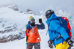 Friends in winter mountains Stock Photos