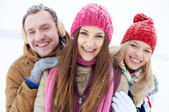 Friends in winter-wear Royalty Free Stock Images