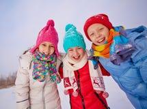Friends in winterwear Stock Images