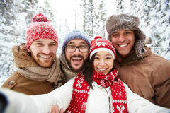 Friends in winterwear Stock Photos