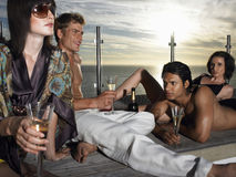 Friends With Champagne On Deck By Sea At Sunset Royalty Free Stock Photo