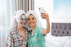 Free Friends With Facial Masks Taking Selfie In Bedroom At Pamper Party Royalty Free Stock Photo - 152568305