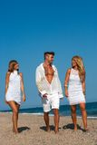 Friends wlking on beach. Royalty Free Stock Photo