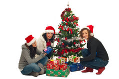Friends women with Christmas tree and gifts Stock Photo