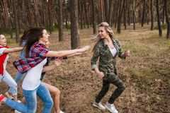Friends women group running competition concept. Chasing  sport game on the nature Stock Photo